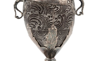 SILVER-MOUNTED CHOCOLATE CUP. MEXICO, 18th Century. Sgraffito coconut skin with silver applications.