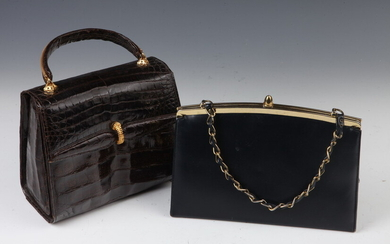 TWO VINTAGE LEATHER BAGS WITH GOLD-TONE CHAIN. One navy blue...