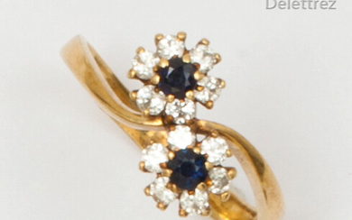 "Yellow gold ""Toi et Moi"" ring, set with two sapphires in a ring of brilliant-cut diamonds. Finger size: 51. Rough weight: 2.6g."