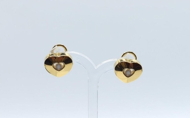 2 earrings in 18 ct yellow gold signed CHOPARD set with 2 brilliants +/- 0.12 ct - 15.3 g raw + original box