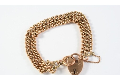 A 9CT GOLD DOUBLE ROW CURB LINK BRACELET with padlock clasp,...