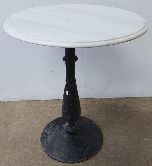 A CAST IRON BASED MARBLE TOP TABLE
