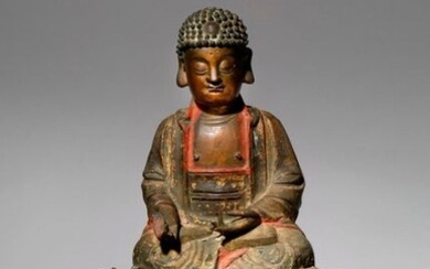 A CHINESE PARCEL-GILT AND LACQUERED-BRONZE FIGURE OF BUDDHA MING DYNASTY Depicted seated in dhyanasana and wearing flowing robes, his bare chest incised with a fylfot, raised on an associated gilt-bronze lotus throne, together with a Qing dynasty...