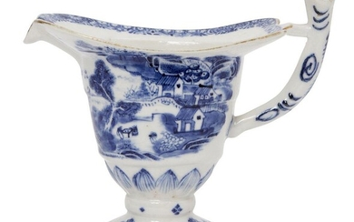 A Chinese porcelain helmet-shaped ewer, Qianlong period, painted in underglaze...