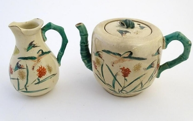 A Japanese teapot and milk jug with hand painted