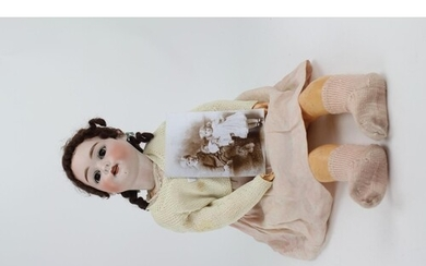 A Late 19th Century German Coloured Bisque Head Doll, Rollin...