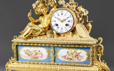 A Mid 19th Century French Gilt Brass and Porcelain...