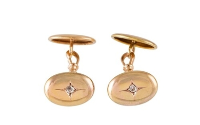 A PAIR OF ANTIQUE GOLD CUFFLINKS, the oval panels set with r...