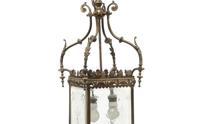 A brass hall lantern with clear cut glass sides. Electrical. Early 20th century. H. 75 cm. W. 25 cm. D. 25 cm.