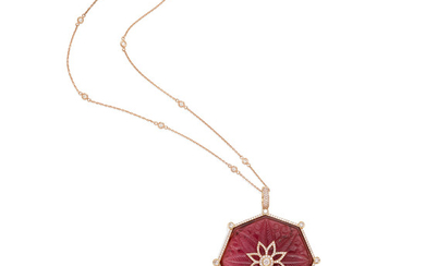 A carved pink tourmaline, colored diamond and diamond pendant