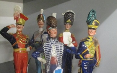 A collection of five Capodimonte ceramic figures modelled as...