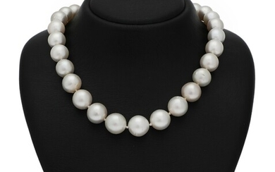 A diamond and pearl necklace set with numerous cultured South Sea pearls and a clasp...