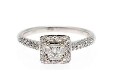 A diamond ring set with a princess-cut diamond weighing app. 0.50 ct. encircled by numerous diamonds, mounted in 14k white gold. Size 53.
