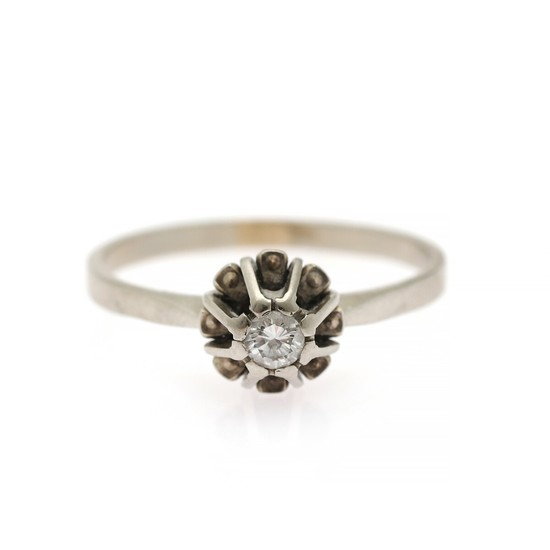 A diamond solitaire ring set with a brilliant-cut diamond weighing app. 0.13 ct., mounted in 14k white gold. Size 57.