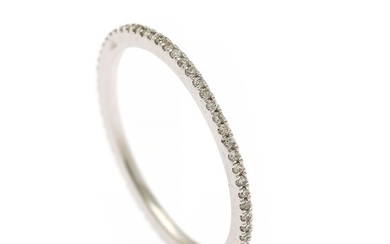 A full diamond eternity ring set with numerous brilliant-cut diamonds, mounted in 14k white gold. W. 1.2 mm. Size 56.