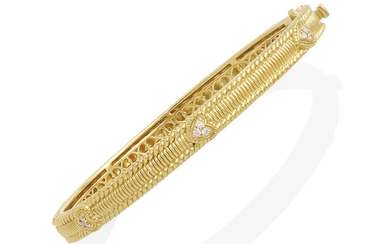 A gold and diamond hinged bangle