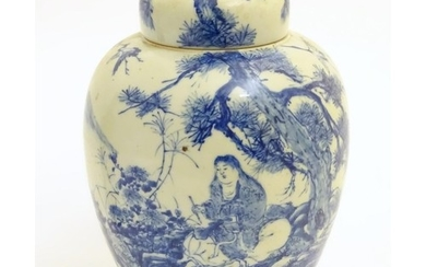 A large blue and white Japanese lidded ginger jar decorated ...