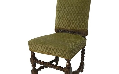A late 19th Century carved oak standard chair on block legs ...
