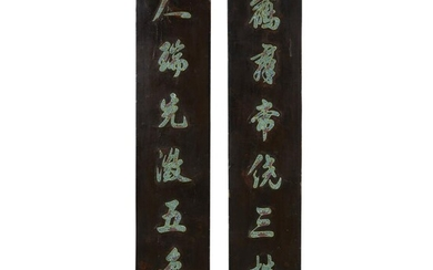 A pair of Chinese porcelain-inlaid rectangular lacquer calligraphy panels...
