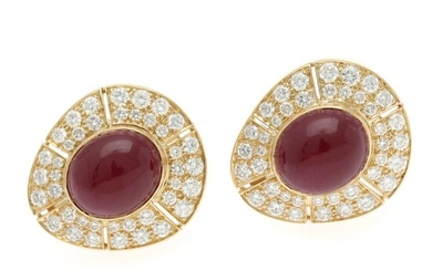 A pair of ruby and diamond ear clips each set with a ruby totalling app. 6 ct. encircled by numerous diamonds totalling app. 3.50 ct., mounted in 18k gold. (2)