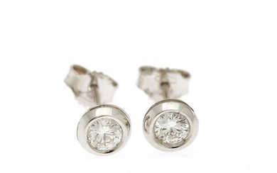 A pair of solitaire ear studs each set with a brilliant-cut diamond totalling app. 0.47 ct., mounted in 18k white gold. (2)