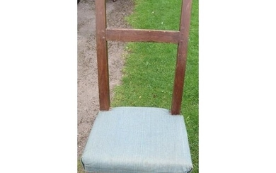 A primitive chair, with upholstered seat and turned front le...