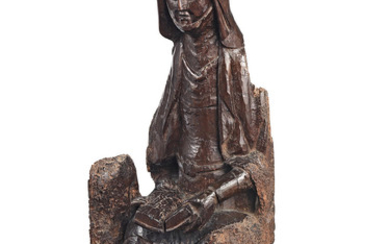 A rare 15th/early 16th century carved walnut figure, French, Saint Anne Teaching the Virgin to Read