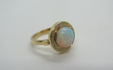A yellow gold opal and diamond ring, tests to 18ct ring size...