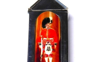 AN UNUSUAL STERLING SILVER AND ENAMEL VESTA CASE Formed as a...