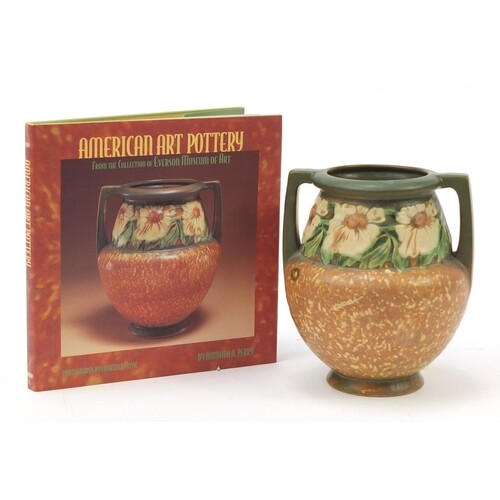 American Roseville art pottery vase with twin handles and a...