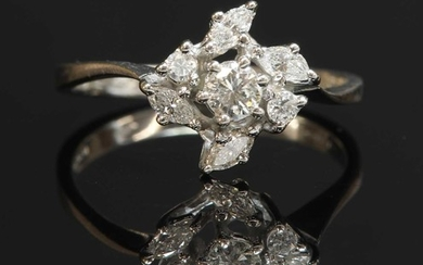 An 18ct white gold diamond cluster crossover ring