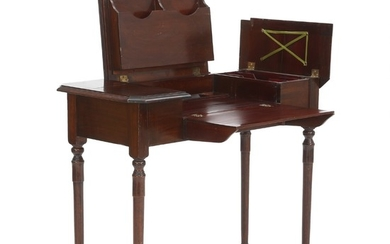 An Edwardian mahogany travel desk. 'The Britisher Desk Company'. England, ca. 1910. H. 76 cm. W. 90 cm. D. 44 cm.