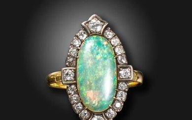 An opal and diamond cluster ring, the oval opal cabochon set within a surround of old cushion-shaped diamonds in silver on gold, with detachable ring section in gold, size Q 1/2