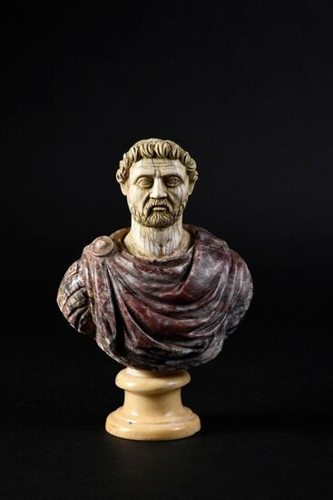 Bust of a Roman emperor, composite, the bust draped in antique breccia violet marble, the head in ivory carved in the style of ancient ivories (restoration at the back), the pedestal in white marble brought back.