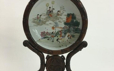 Chinese porcelain charger mounted in wood stand