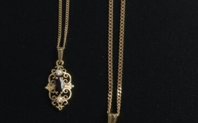 18k yellow gold chain link necklace holding an 18k yellow gold pendant set with a faceted oval almandine garnet in a setting of twelve round almandine garnets.