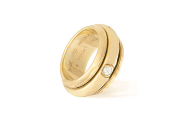 """Description A GOLD AND DIAMOND """"POSSESSION"""" RING, BY PIAGET,..."""