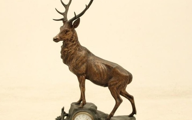 Large French patinated bronze clock with stag