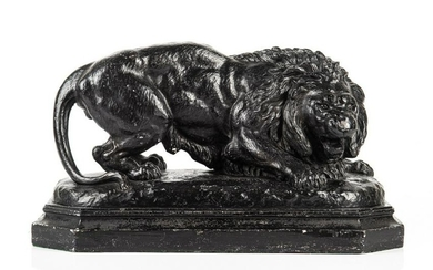 PAINTED PLASTER STATUE OF CROUCHING LION