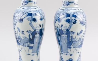 PAIR OF CHINESE BLUE AND WHITE PORCELAIN VASES In meiping form, with figural cartouches on a floral ground. Double ring marks on bas...