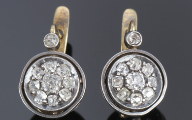 Pair of diamond rosette earrings, 18 kt. gold and silver. Late 19th century. (2)
