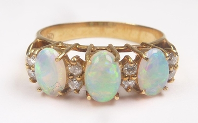 Ring with three opals and four pairs of tiny diamond brillia...