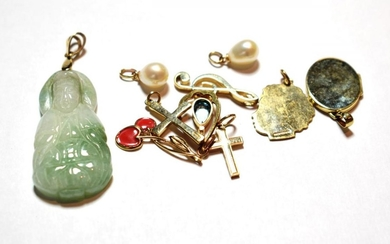 Six 9 carat gold charms/pendants including two crosses, a locket,...