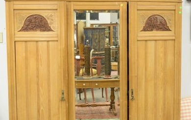 Three door pine armoire, having fitted drawers. ht. 91
