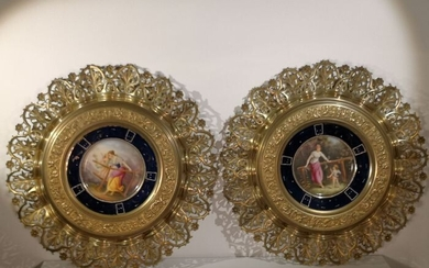 Two bronze wall plaques with porcelain inserts. (2) - Porcelain - circa 1880-1919