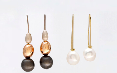 Two pairs of gold and silver long earrings.