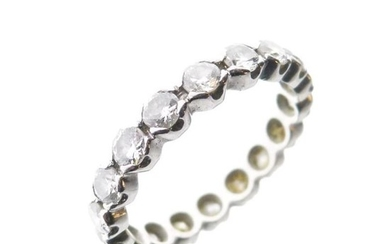 Unmarked white metal and diamond full eternity ring, size...