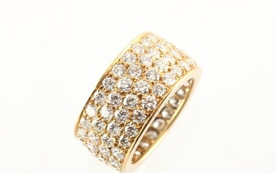 Van Cleef & Arpels - an 18ct yellow gold diamond eternity ri...