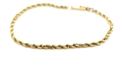 Yellow gold rope chain bracelet with a barrel clasp and safe...