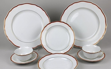9 pieces porcelain Meissen, 2nd half of the 20th century, form new cutout, decoration coral with golden rim, consisting of: 2 big plates, d: 28 cm, blue swords mark with abrasive line underneath; 2 place settings with tea cups, blue swords mark 1st...